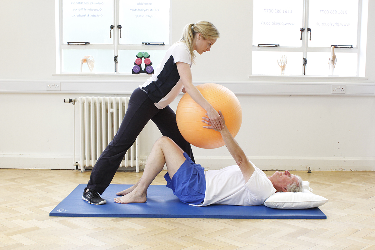 Exercise ball with elderly treatment at Manchester Physio clinic