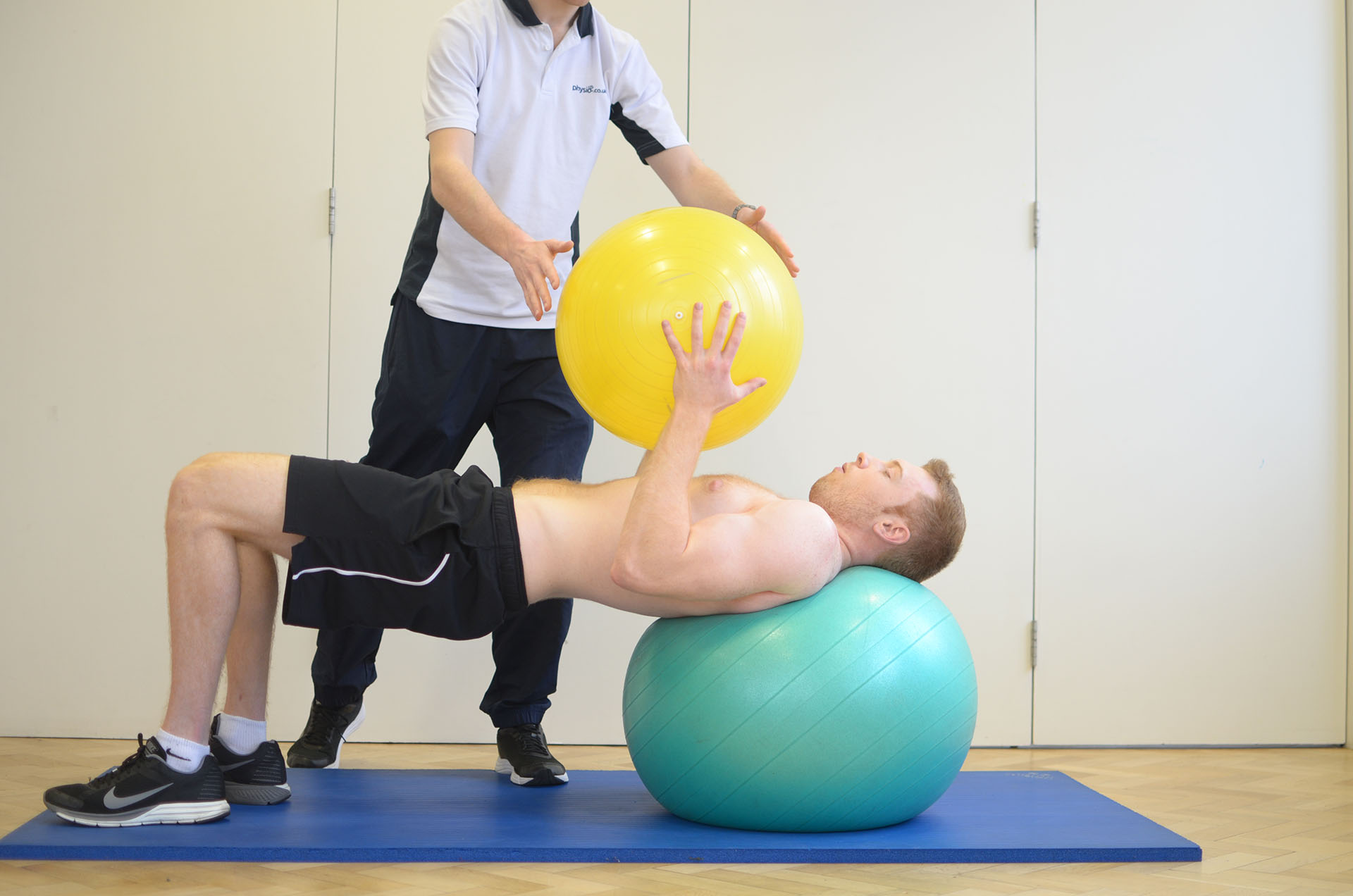 Exercise ball therapy at Manchester Physio clinic