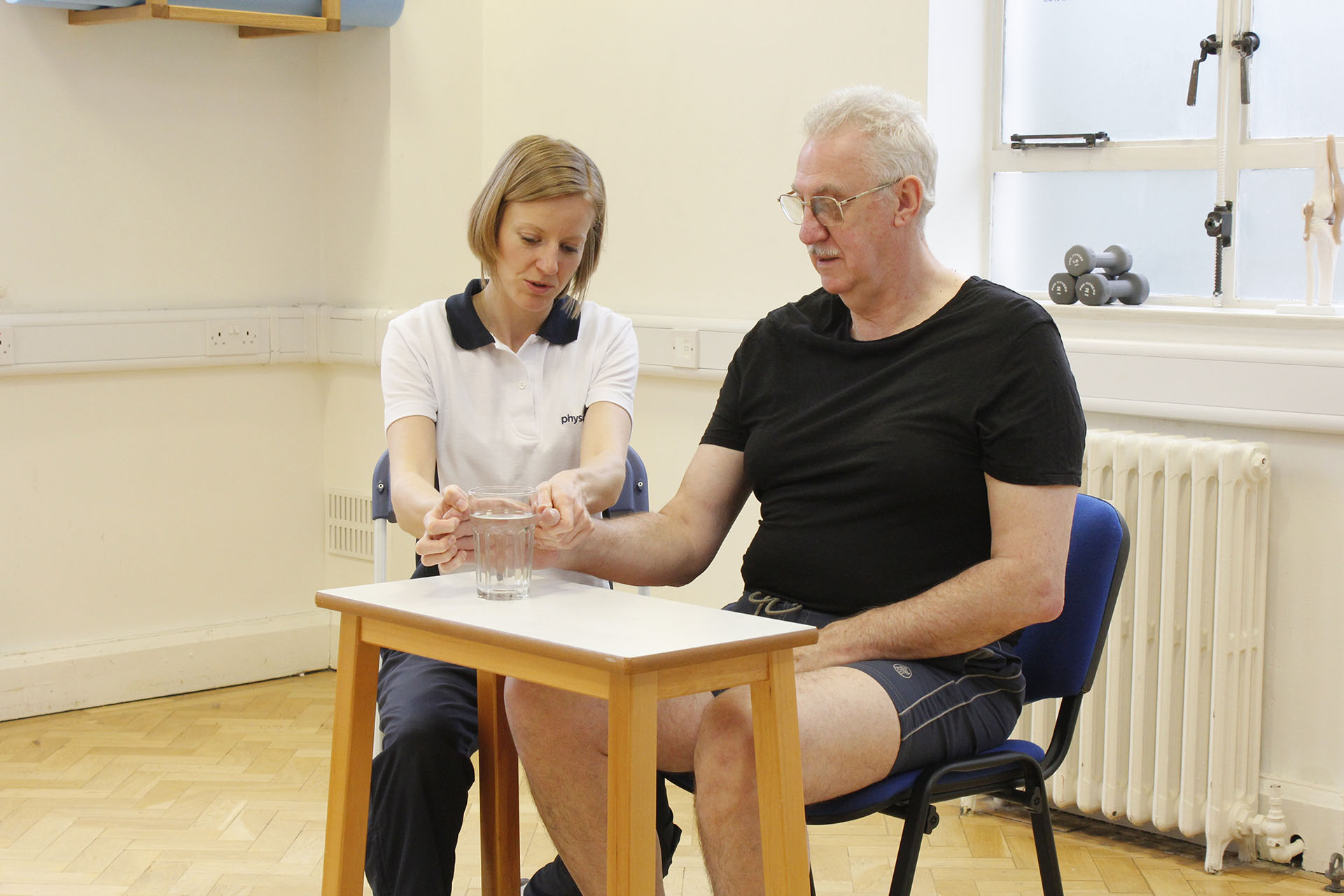 Elderly therapy session in Manchester Physio Clinic
